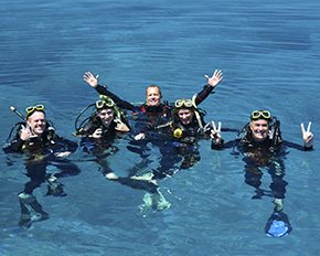 dive instructor with students on surface of water