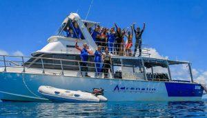 passengers posing on MV adrenalin at the reef