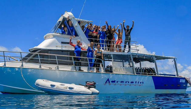 passengers posing on MV adrenalin at the reef