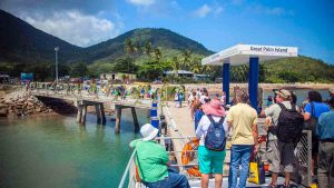 tourists arriving on palm island jetty