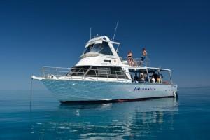 MV Adrenalin anchored on Lodestone Reef on glass-like water surface