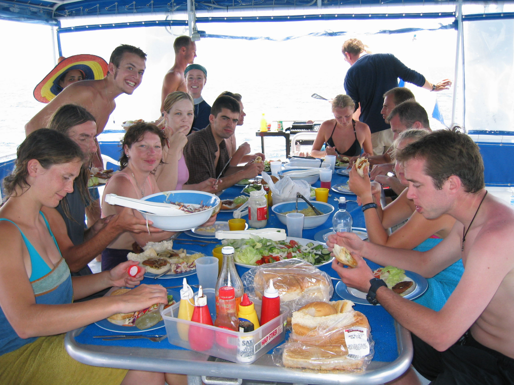 passengers having lunch on Mv SeaEsta's large entertainment deck
